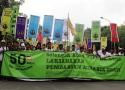 Barisan massa petani SPI dalam Aksi Hari Tani Nasional dan Peringatan 50 Tahun UUPA